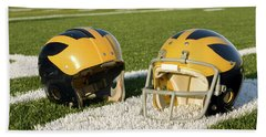 Wolverine Helmets From Different Eras On The Field Beach Sheet