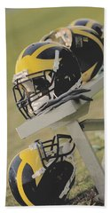 Wolverine Helmets On A Football Bench Beach Sheet