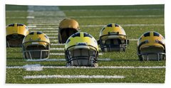 Wolverine Helmets Throughout History On The Field Beach Sheet