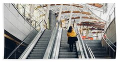 Woman Going Up Escalator In Milan, Italy Beach Towel