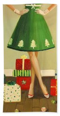 Woman In Green Dress With Holiday Presents And Christmas Bulbs Beach Towel