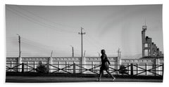 Beach Towel featuring the photograph Woman Walking In Industry by John Williams
