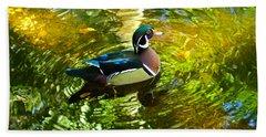 Wood Duck In Lights Beach Towel by Judy Wanamaker