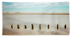 Beach Towel featuring the photograph Wood Pilings In Shallow Waters by Colleen Kammerer