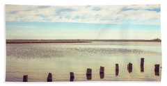 Beach Towel featuring the photograph Wood Pilings In Still Water by Colleen Kammerer