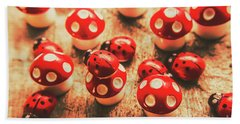 Wooden Bugs And Plastic Toadstools Beach Towel