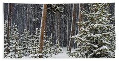 Woodland Snowstorm In Yellowstone Beach Towel