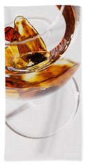 Beach Towel featuring the photograph Yellow Amber Stones In A Glass. by Andrey  Godyaykin