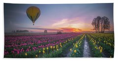 Beach Towel featuring the photograph Yellow Hot Air Balloon Over Tulip Field In The Morning Tranquili by William Lee