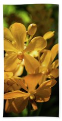 Yellow Orchid Beach Towel by Jocelyn Kahawai