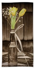 Beach Towel featuring the photograph Yellow Tulips In Glass Bottle Sepia by Terry DeLuco