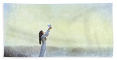 Young Lady Releasing A Dove By The Sea Beach Sheet by Jill Battaglia