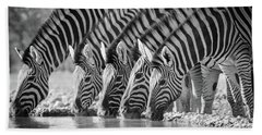 Zebras Drinking Beach Towel by Inge Johnsson
