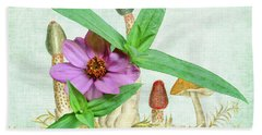 Zinnia In The Mushrooms Beach Towel by Larry Bishop