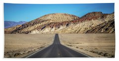 Beach Towel featuring the photograph Lonely Road In Death Valley National Park In California by Alex Grichenko