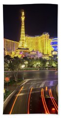 Beach Towel featuring the photograph Nigh Life And City Skyline In Las Vegas Nevada by Alex Grichenko