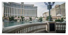 Beach Towel featuring the photograph Bellagio Hotel And Other Architecture In Las Vegas Nevada by Alex Grichenko