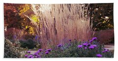 A Flower Bed In The Autumn Park Beach Towel