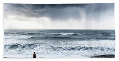 A Woman In The Sea On A Stormy Day  Beach Towel