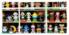 Bobbleheads In Store Window In Schroon Lake Ny In Adirondacks Beach Towel