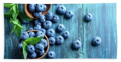 Bowl Of Fresh Blueberries On Blue Rustic Wooden Table From Above Beach Towel