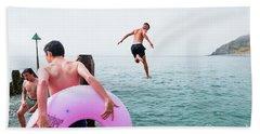 Boys Jumping Into The Sea Beach Towel