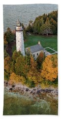 Beach Towel featuring the photograph Cana Island Lighthouse At Dawn by Adam Romanowicz
