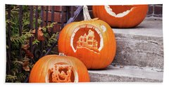 Beach Towel featuring the photograph Carved Pumpkins For Autumn Holidays by Tatiana Travelways