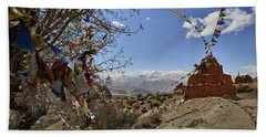 Chortens And Prayer Flags With Mountain Beach Towel
