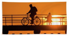 Cyclist Silhouetted At Sunset Beach Towel
