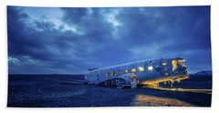 Beach Towel featuring the photograph Dc-3 Plane Wreck Illuminated Night Iceland by Nathan Bush