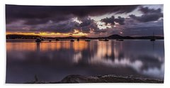 First Light With Heavy Rain Clouds On The Bay Beach Towel