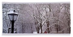 Beach Towel featuring the pyrography First Snow by Elly Potamianos