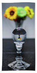 Beach Towel featuring the photograph Flowers And Crystal Ball by Lora J Wilson