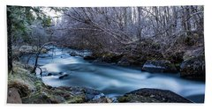 Frozen River Surrounded With Trees Beach Towel