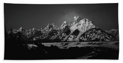 Full Moon Sets In The Tetons Beach Towel