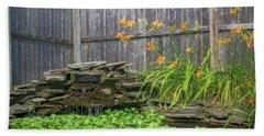 Garden Pond With Orange Day Lilies Beach Towel