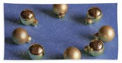 Golden Christmas Balls On The Snowy Background Beach Sheet