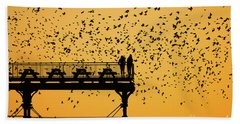 Golden Hour Starlings Over Aberyswyth Pier Beach Towel