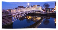 Beach Towel featuring the photograph Ha'penny Bridge At Blue Hour by Barry O Carroll