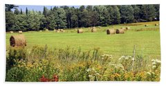 Beach Towel featuring the photograph Hay Bails And Wild Flowers by Tatiana Travelways