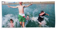 Jetty Jumping Into The Sea Beach Towel