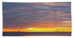 Beach Towel featuring the photograph Light On The Horizon by Jeff Sinon