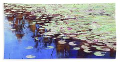 Lilies On Blue Water Beach Towel