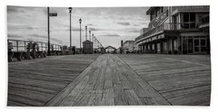 Beach Towel featuring the photograph Low On The Boardwalk by Steve Stanger