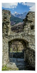 Beach Towel featuring the photograph Mesocco Castle Gate With Mountains by Dawn Richards