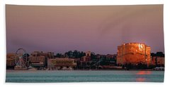 Beach Towel featuring the photograph National Harbor Reflecting The Sunset by Lora J Wilson