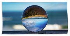 Beach Towel featuring the photograph Ocean Through The Lens Ball by Lora J Wilson