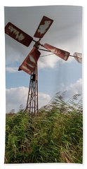 Beach Towel featuring the photograph Old Rusty Windmill. by Anjo Ten Kate