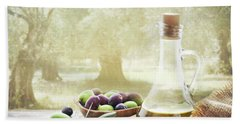 Olives And Bottle Of Olive Oil On Wooden Table In Olive Garden Beach Towel